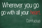 "famous Confucius quote ""Wherever you go, go with all your heart"" handwritten on a blackboard"